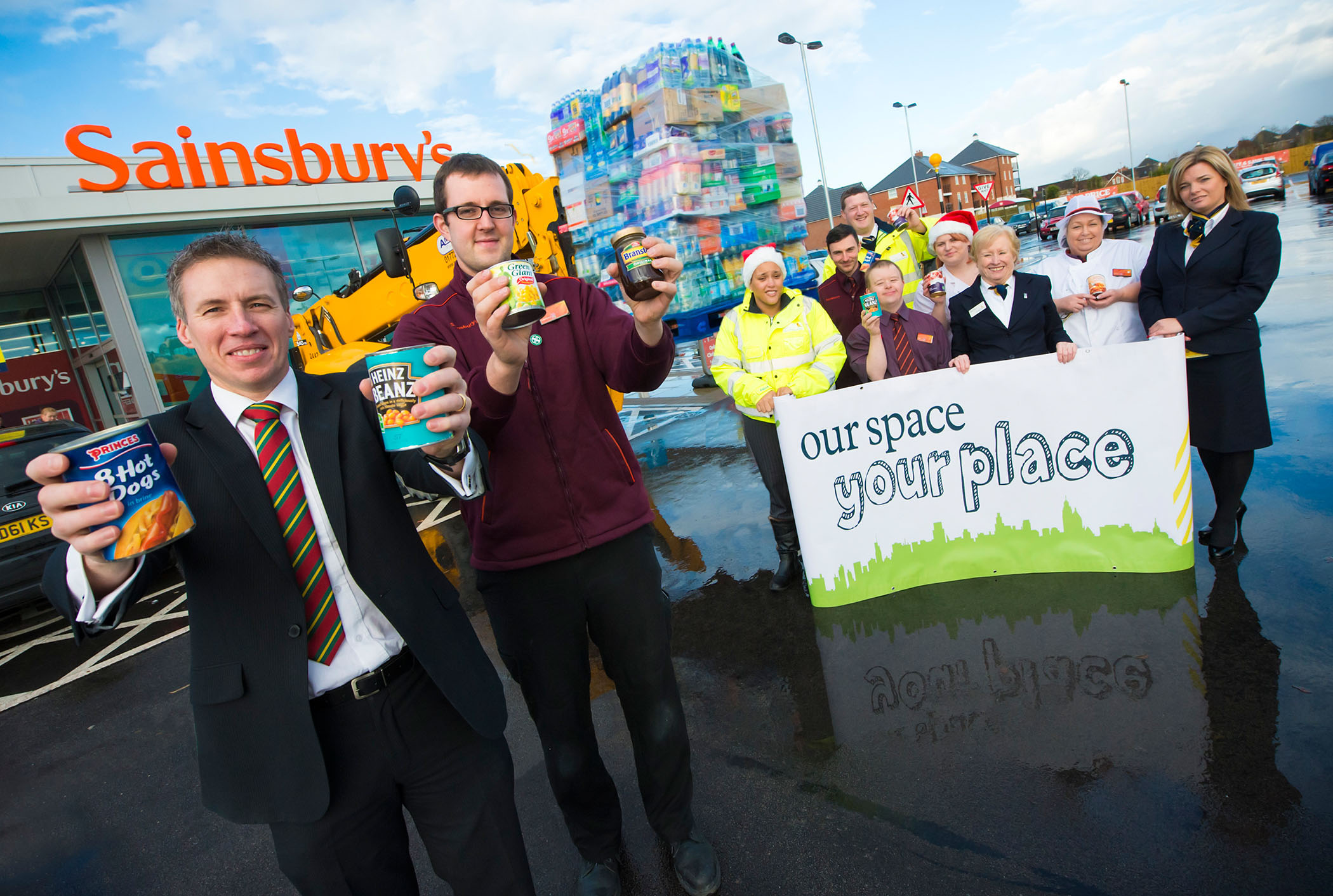 Justin Corner, David Wilson Homes North West and Pete Webb, Fresh Food Manager at Sainsbury's with staff from the two firms launching the Christmas appeal