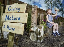 DWH David Wilson Homes new show home has a special garden designed for insects and wild animals. Pictured at the Cromwell Heights in Longridge, Preston site Lyra Coolican aged 4 building an insect home