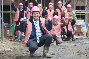 Davis Wilson Homes site Winnington Village in Northwich Cheshire celebrate Breast Cancer Awarness Month by wearing pink hats and hi-vis jackets on site. Pictured site manager Stuart Kirby