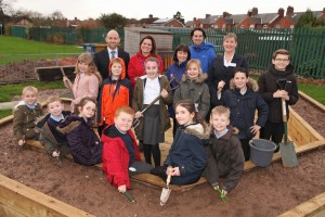 As part of the Our Space Your Place scheme David Wilson Homes have helped St Chad's Primary School to transform their playground. 1) Provided top soil for an allotment 2) Given them £1,000 cheque for fencing works Pictured with pupils from St Chad's Primary School, Winsford: (black suit) Kristianne Edmondson Sales Advisor charlotte place winsford (suit and tie) Andrew Taylor Planning Director (blue coat) Louise Dodd School Business Manager (red fleece) Natalie Tomlinson Head Teacher (longer hair, blue coat) Rikki Lloyd Year 4 Teacher & Sports Lead Picture: Jason Lock