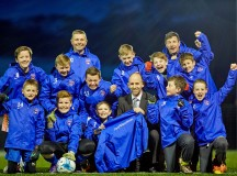 DWH David Wilson Homes have sponsored the Sandbach Under 11 football team's training coats, Pictured front centre - Toby Cookson aged 10, Andrew Taylor from DWH with the rest of the team.