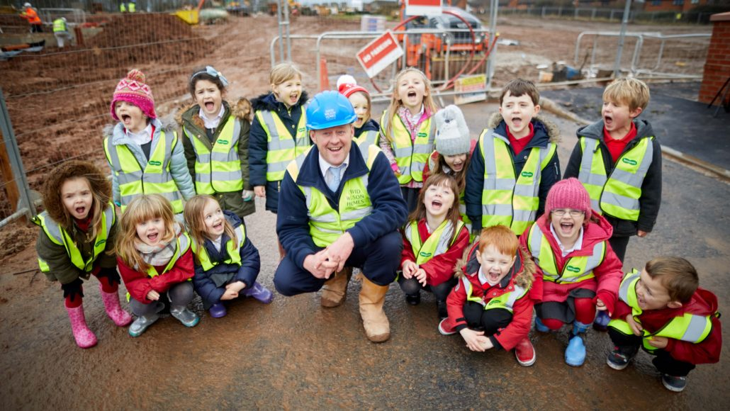 Cheshire visit to Haddington Park, a David Wilson Homes development in their village.  Pictured some of the children with site manager Ian Wilson