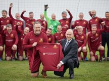 David Wilson Homes sponsorship of St Mary's veteran team in Crosby pictured Andrew Taylor from DWH presents the new kit to the team