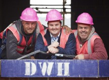 Davis Wilson Homes  site  Winnington Village in Northwich Cheshire celebrate Breast Cancer Awarness Month by wearing pink hats and hi-vis jackets on site.  Pictured Paul Lilley from Kidsgrovesite manager Stuart Kirby - Glenn Millar from Northwich