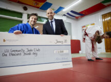 Paul Benson (blue) has started running a Judo class at L21 in Bootle, Liverpool.    Andrew Taylor From DWH North West and Barratt have donated £1000 to help them support the community.
